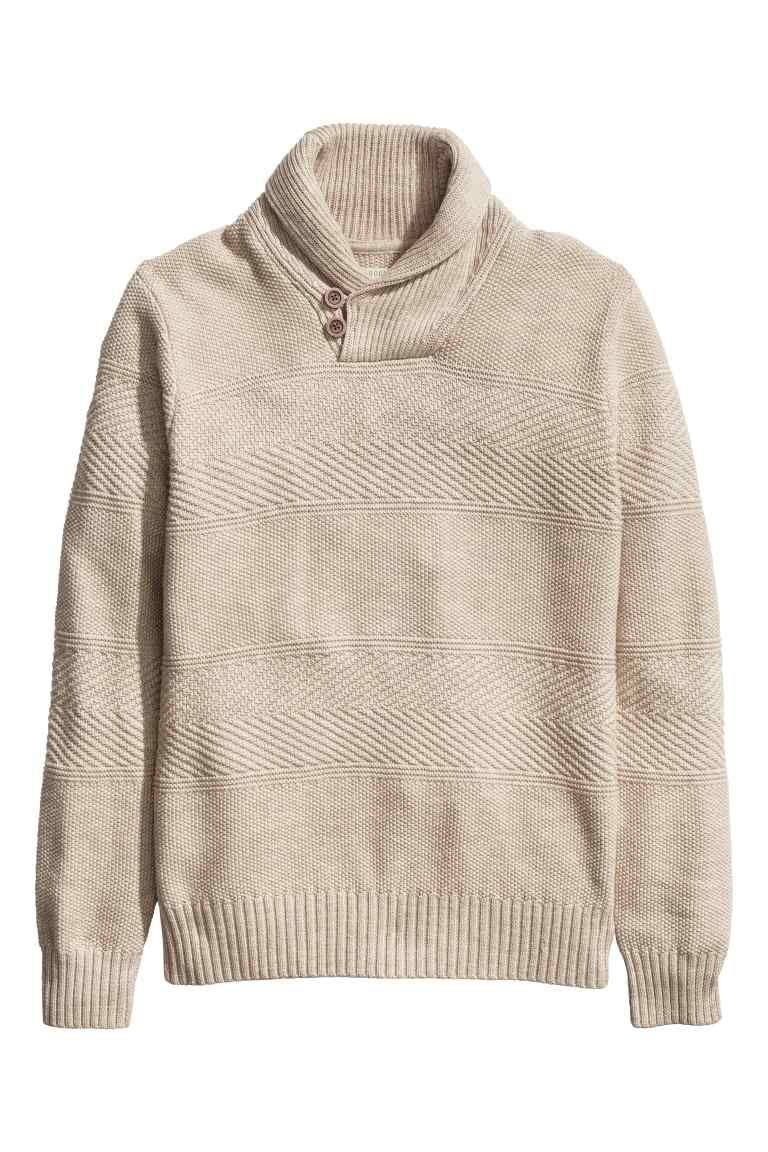 ec7f07d54 Camisola em malha de algodão  Camisola em malha fantasia de algodão. Tem  gola xale com botões na frente e punhos e cós em malha canelada.