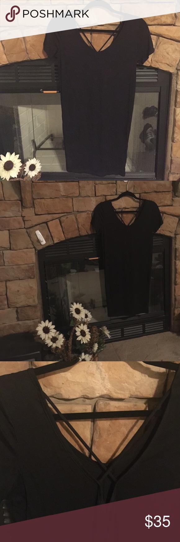 Little Black Tunic ❤️ Black tunic with a criss-cross back. 95% Rayon 5% Spandex. Ezra Tops Tunics