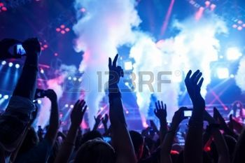 happy DJ: Picture of rock concert, music festival, New Year eve celebration, party in nightclub, dance floor, disco club, many people standing with raised hands up and clapping, happiness and night life concept