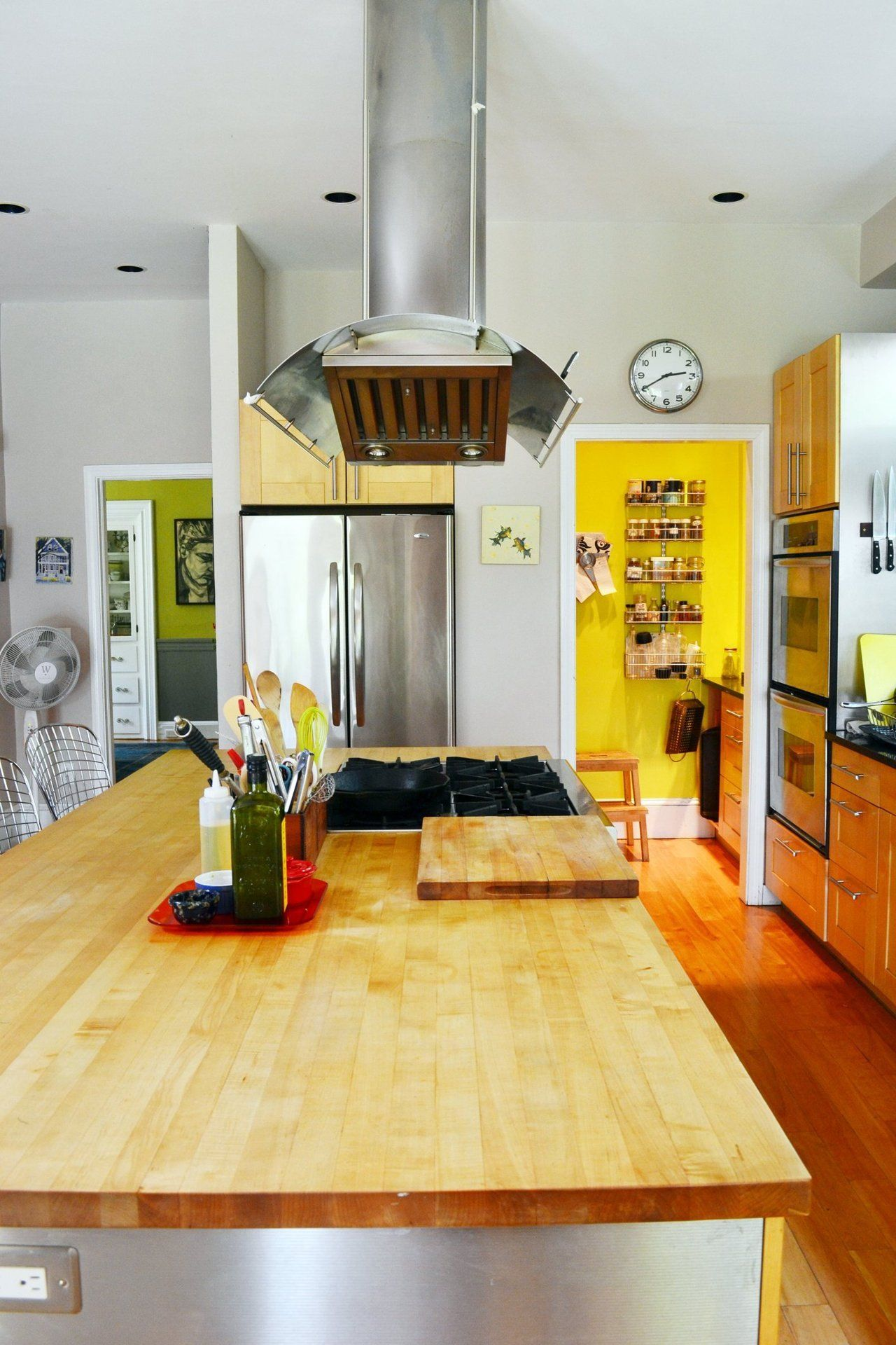 Eva & Philip\'s Art-Filled Wanderlust Home | Yellow accent walls ...