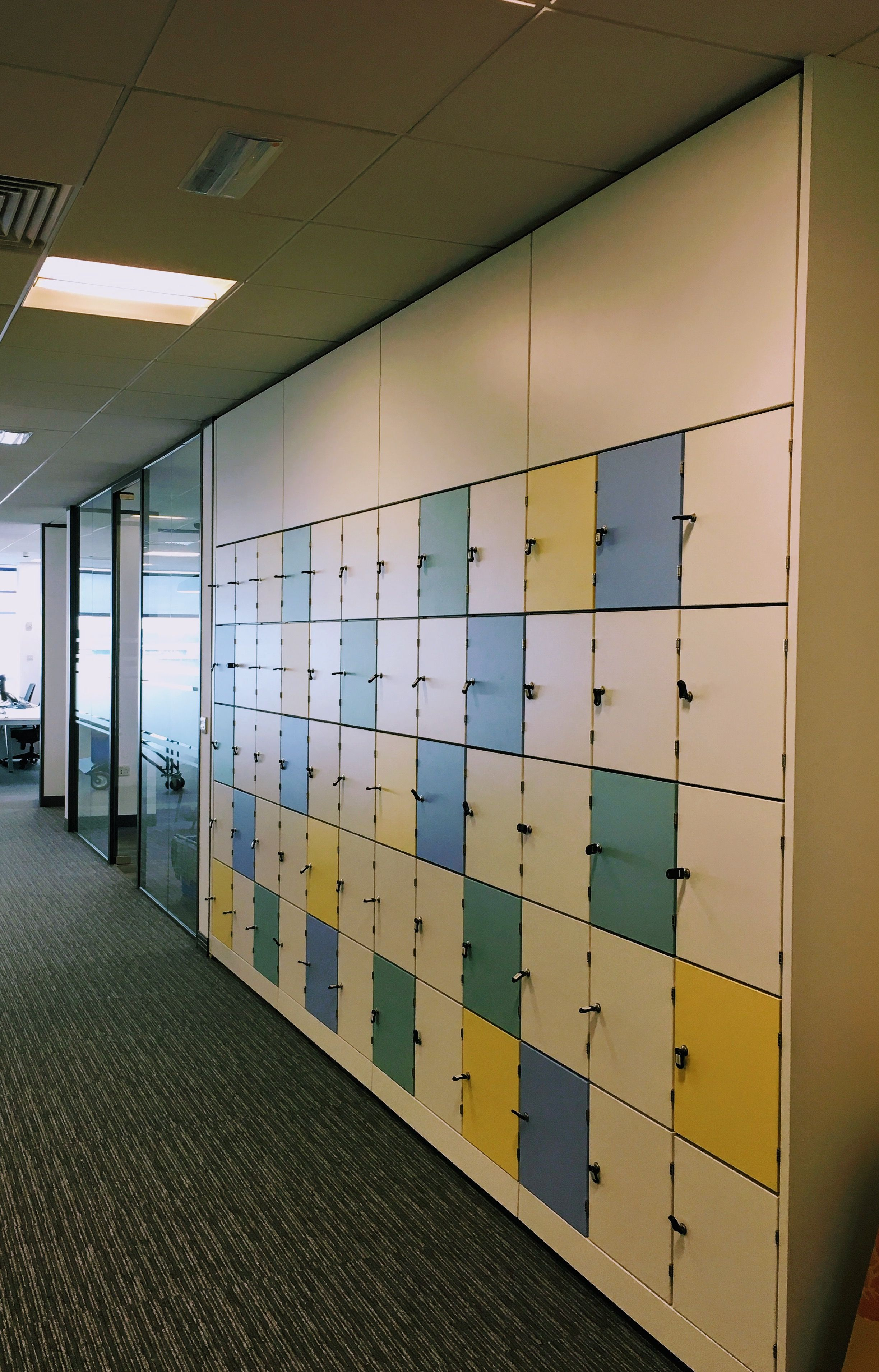 personal office design. Built In Locker Wall For Personal Storage Within A Large Corporate Office. Courtesy Of Aztec Interiors (Northern) Ltd. #fitout #officedesign #officespace Office Design