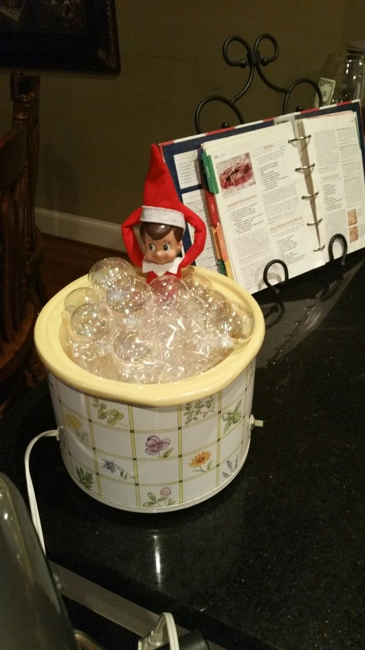 Jolly relaxing in a bubble bath. Elf on the Shelf. Plastic & clear ornaments.