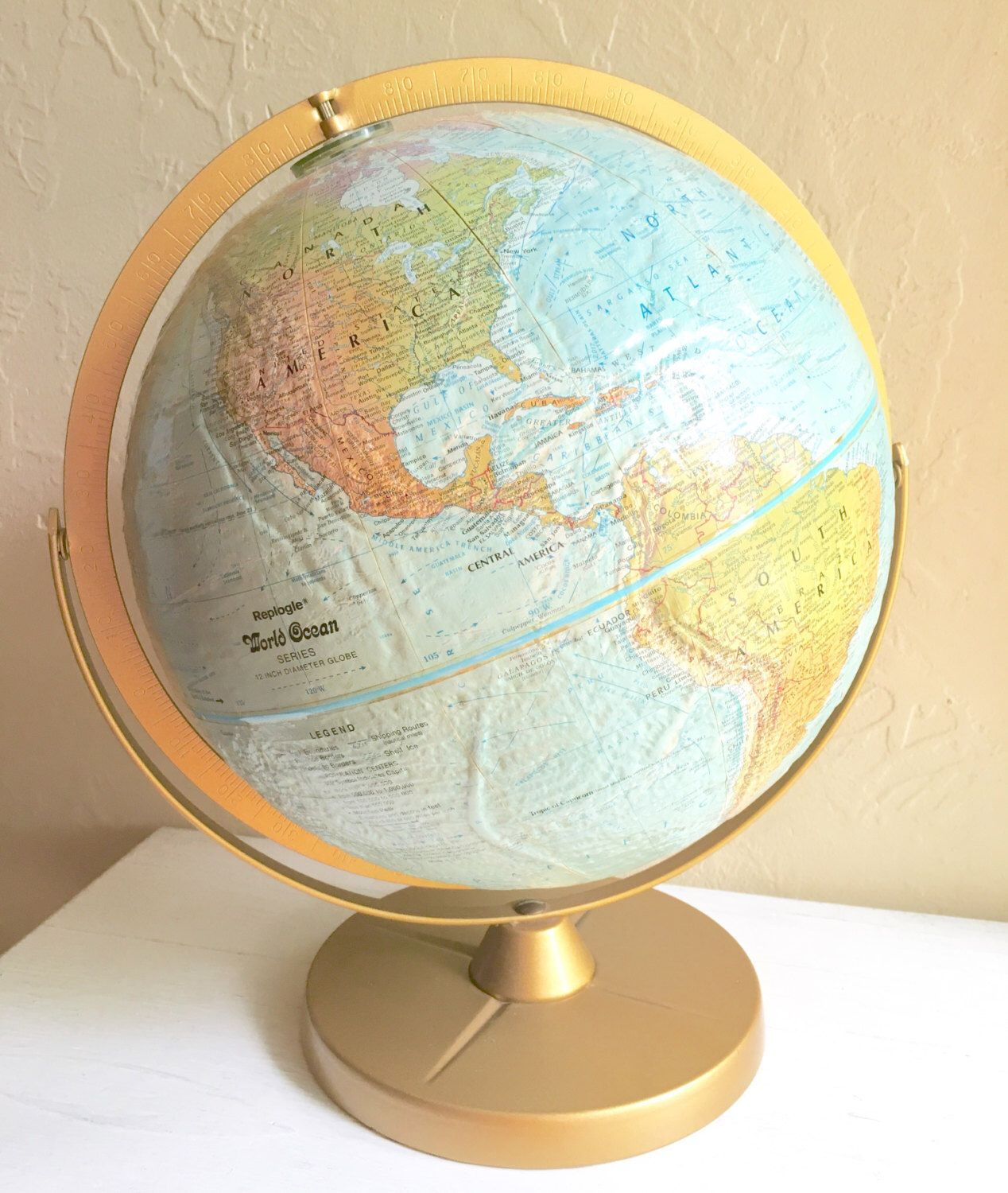 A personal favorite from my Etsy shop https://www.etsy.com/listing/451639490/large-vintage-world-globe-with-gold