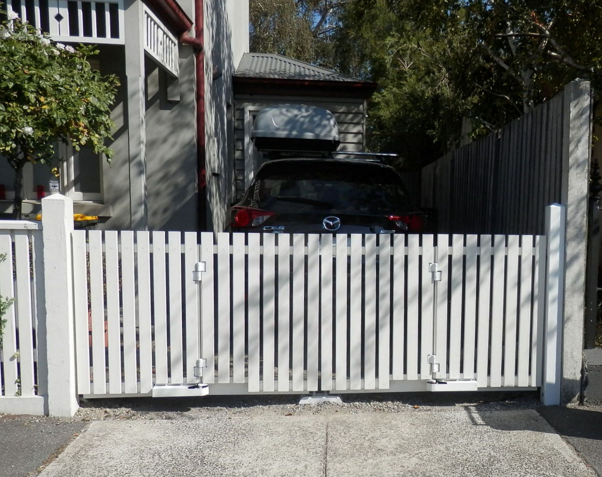 Bi fold trackless automatic gates Timber picket style Perfect for