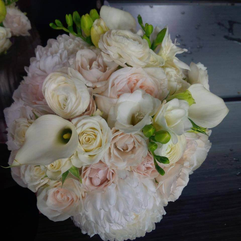 A packed #blush and #white  #BridalBouqet designed by #LiliesWhiteFloralStudio. #Chrysanthemums, #CallaLilies #Freesia, #Roses