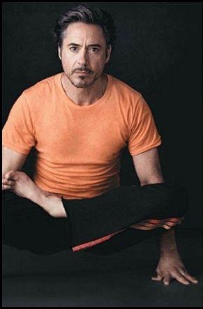 RDJ doing yoga.  Be still my heart!