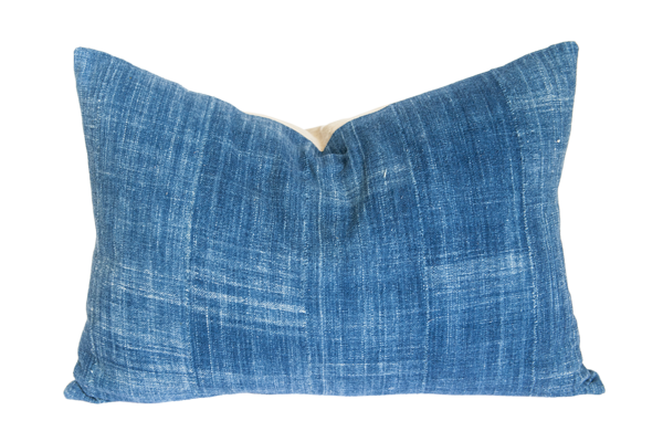 """Authentic African Mudcloth is hand spun, woven and dyed by artisans. All cushions are sold with our premium feather and down inserts. Sold individually.  16""""x26"""" Color:Indigo Backing: 100% Cotton Knife edge construction Hidden zipper Includes feather and down insert Made in Africa Dry clean only  Due to the handmade nature of this product, there may be slight imperfections and patterns may vary slightly. All cushions are non-returnable."""