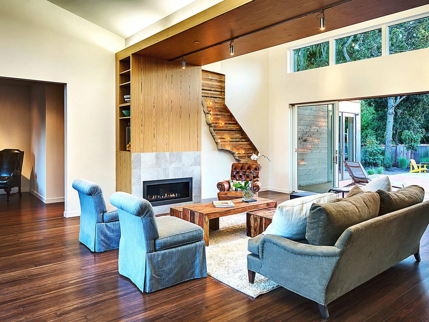 like the bookcase incorporated into the fireplace  scale of room is good