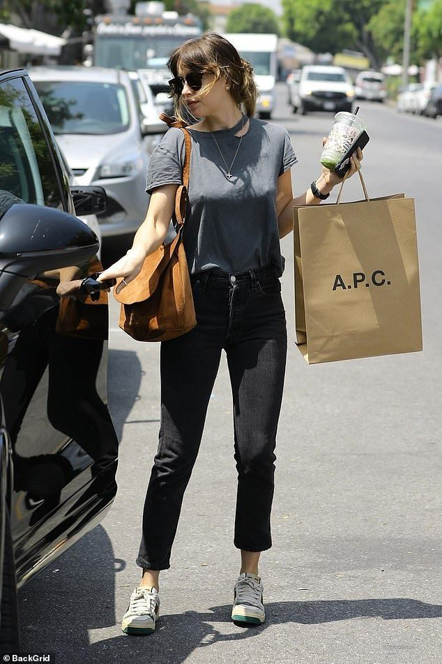 Photo of Dakota Johnson dons casual style as she goes bra free while shopping