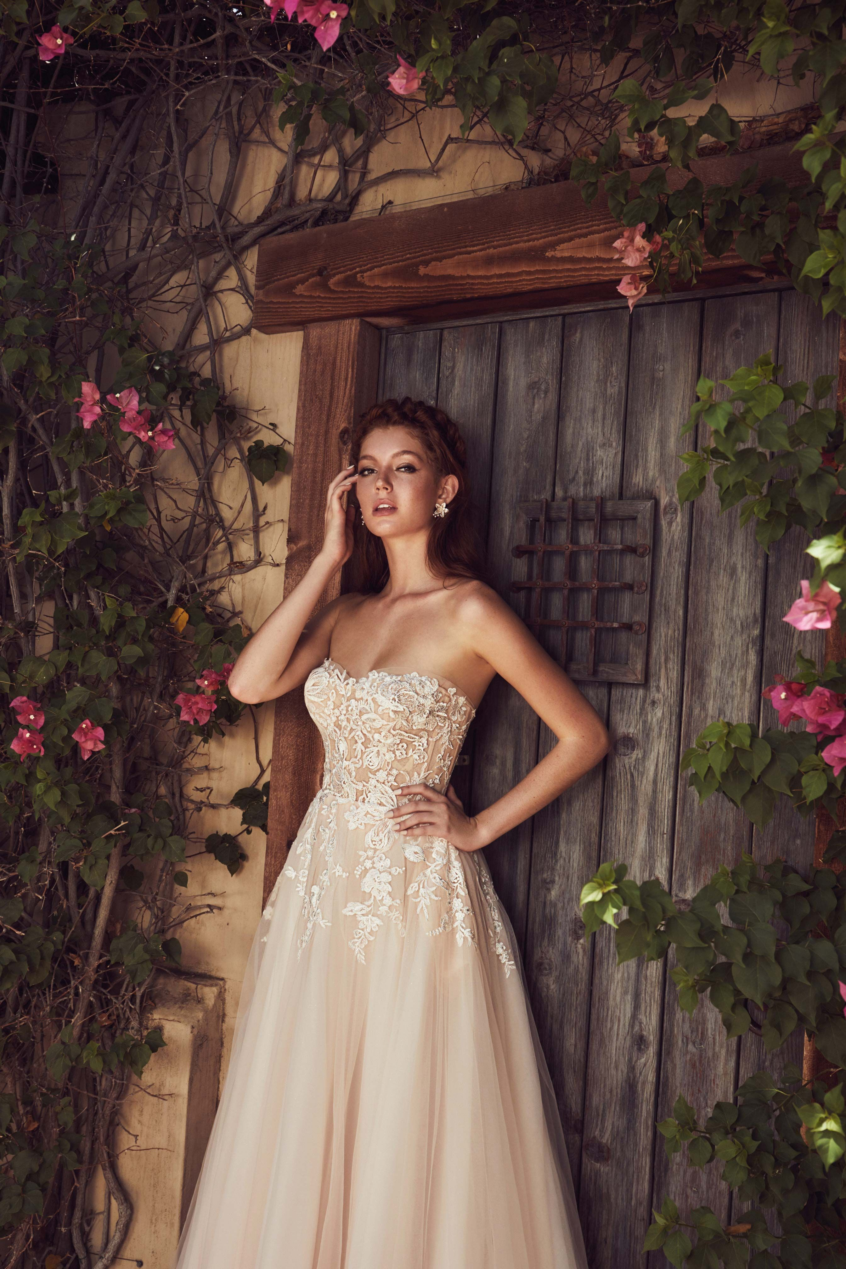 A Line Gown In Blush Strapless With A Shimmer Sparkle Skirt
