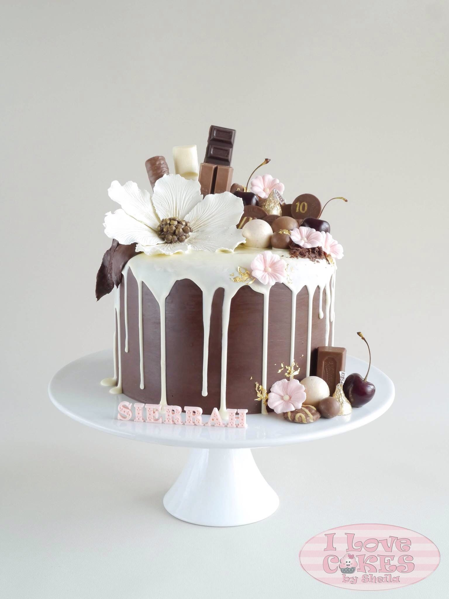 Drippy Chocolate Cake With Beautiful Flowers Decorating The Top