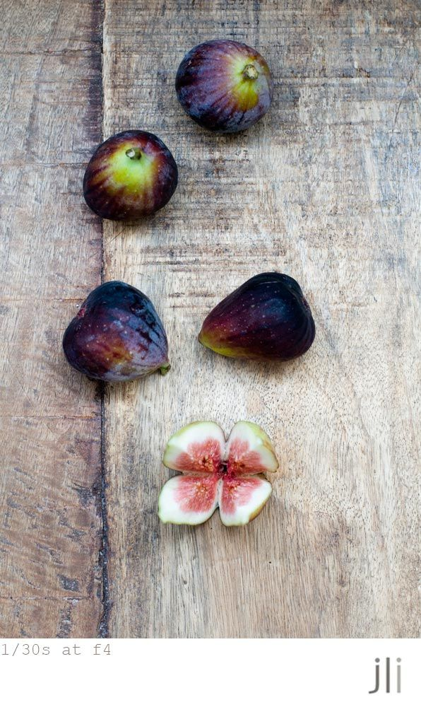 photography of figs in dark purple on grey wooden table | fruit: fig . Frucht: Feige . fruit: figue | Photo: Jillian Leiboff |