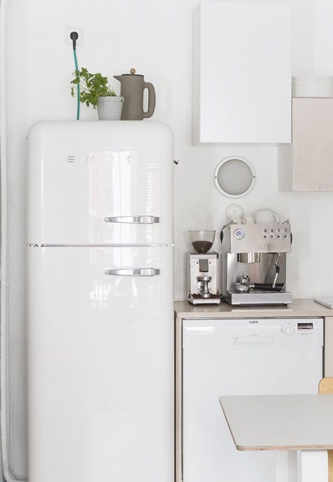 A Compact, Stylish Kitchen Complete With White Smeg Fridge