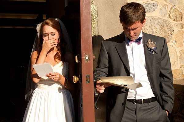A shot of the couple before the wedding, reading each other's ...