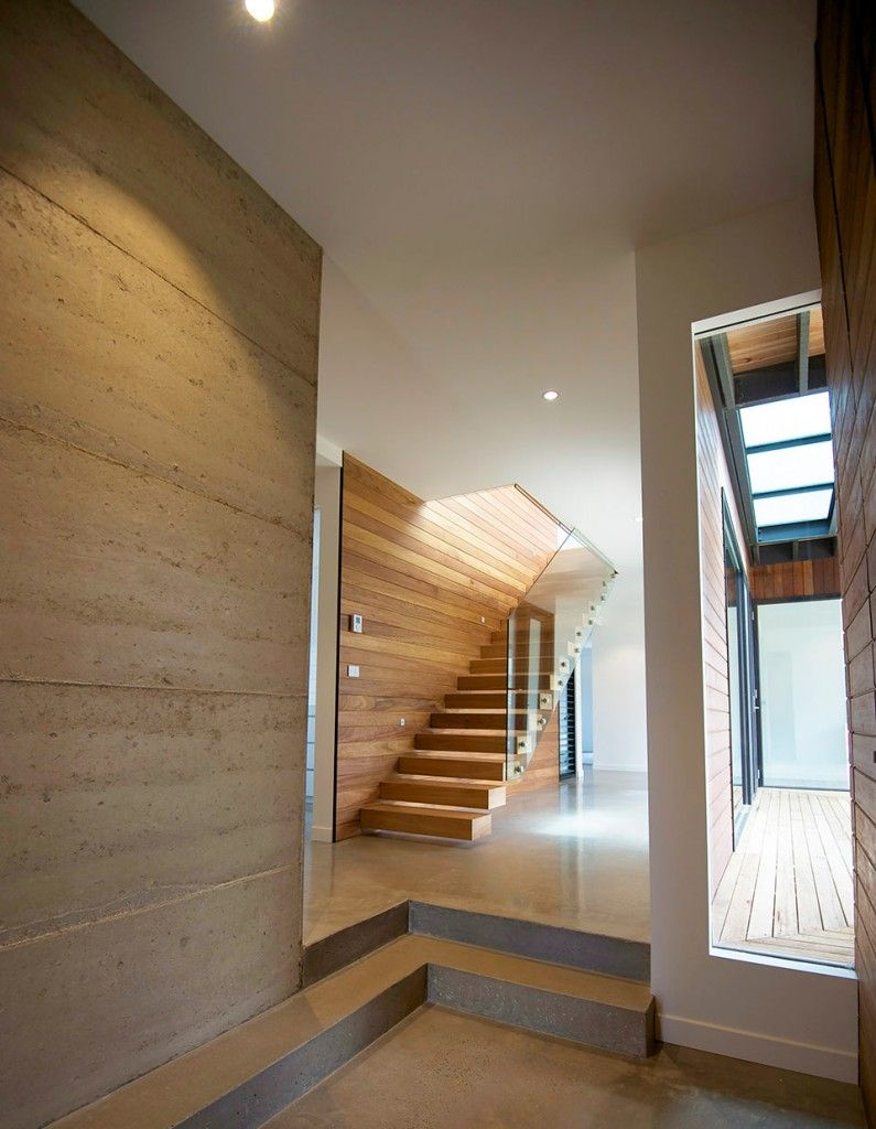 Like Rammed Earth feature wall and the colour of the wood which ...