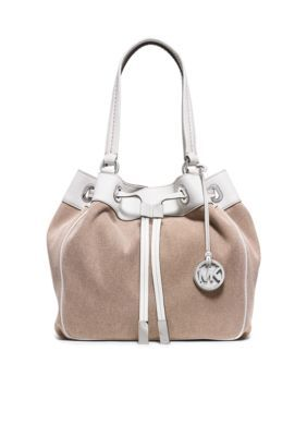 0b8b0ce9ed79 Stunning MICHAEL Michael Kors Marina Large Drawstring Tote constructed from  washed cotton canvas with contrasting white leather trim.