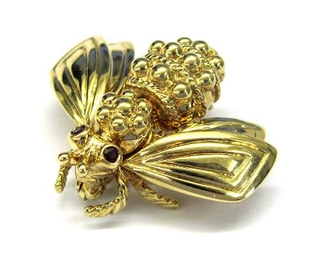 Ladies 18kt yellow gold gemstone tiffany bee estate pin. Pin contains 2 round cut ruby gemstones. Pin weighs 7.4 grams of 18kt yellow gold.
