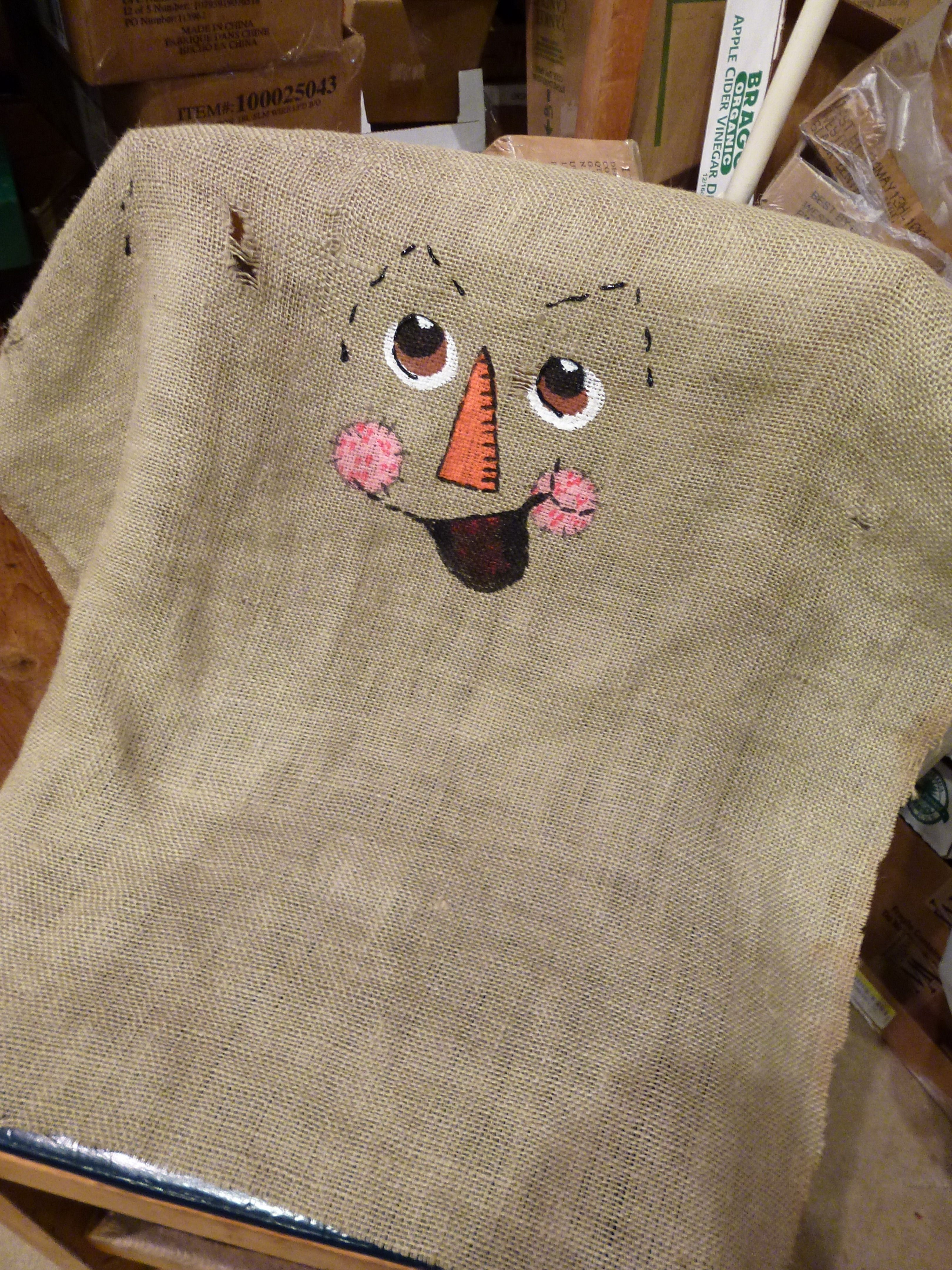 Scarecrow Painting A Face On Burlap