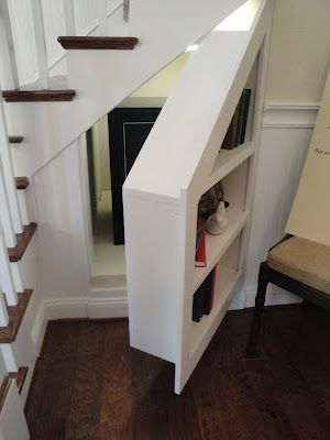 Here's another hidden room under a staircase but instead of rising up to  reveal the room