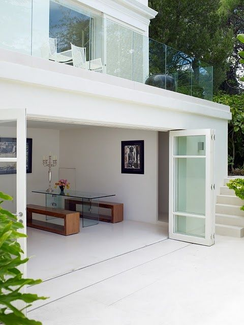 clean & contemporary - indoor/outdoor living with sliding glass shutter doors