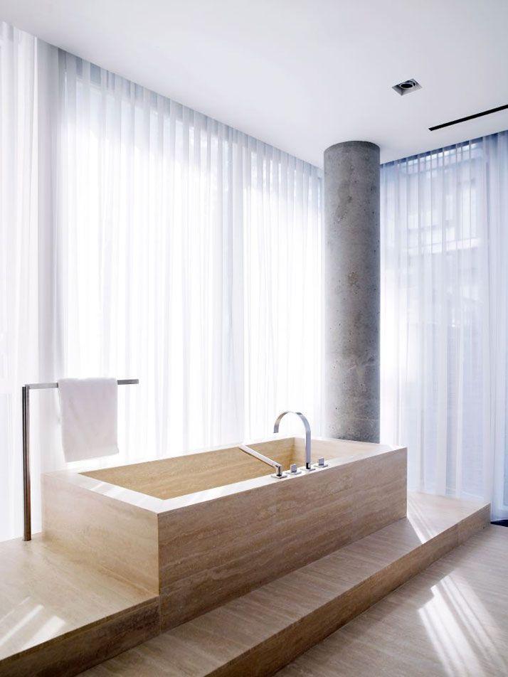 Travertine marble bathtub in George Yabu and Glenn Pushelberg's Apartment in New York.