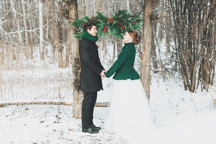 Bride wears evergreen cardigan - Christmas winter wedding ceremony in snow | fabmood.com #wedding #winterwedding #christmas #christmaswedding