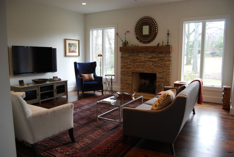 Splitting up tv and fireplace for lovelier focal point. Furniture arrangement isn't bad either ...