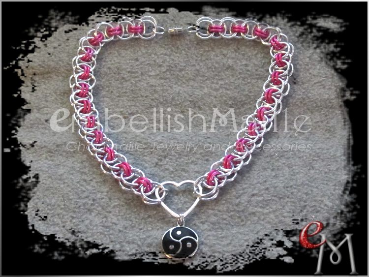 https://www.etsy.com/shop/EmbellishMaille - Helm chain with silver and hot pink rings, heart shaped accent front ring and dangling celtic triskelion symbol.