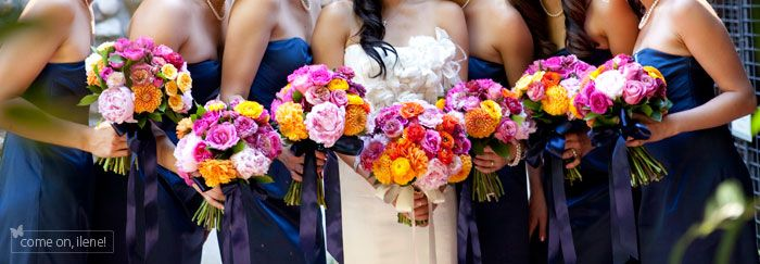 Like The Navy Bridesmaids With Bright Flowers