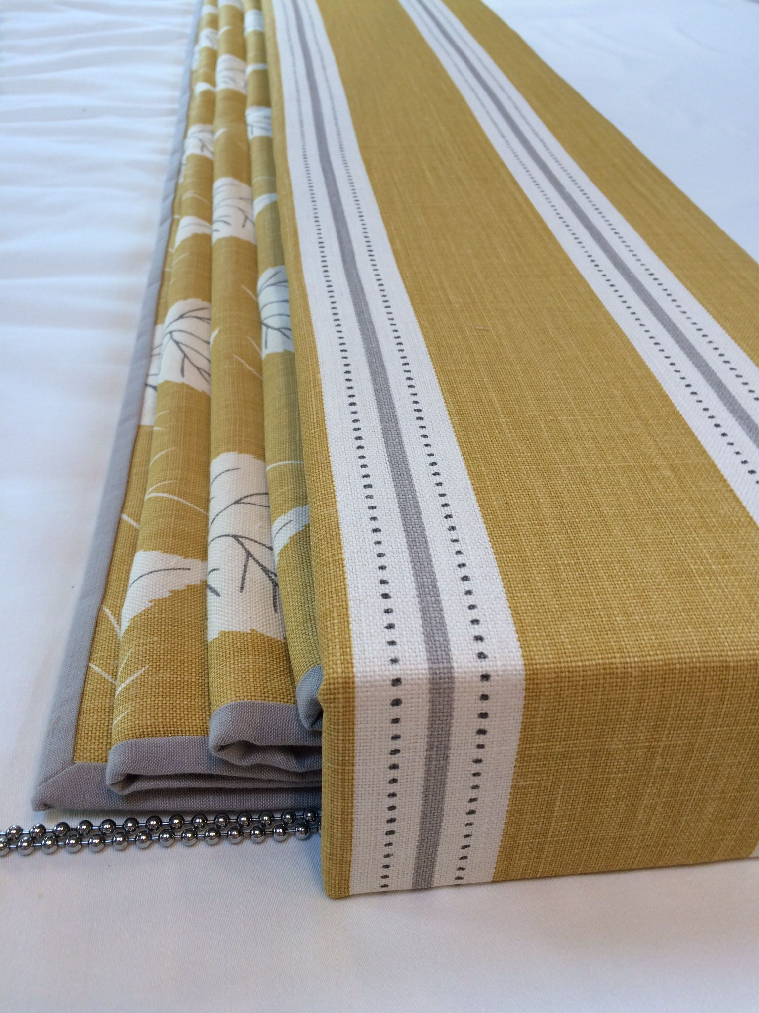 Contrast bordered roman blind given that added interest with a