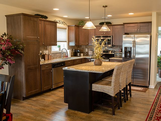 Transitional kitchen by embee and son cabinetry flooring and more