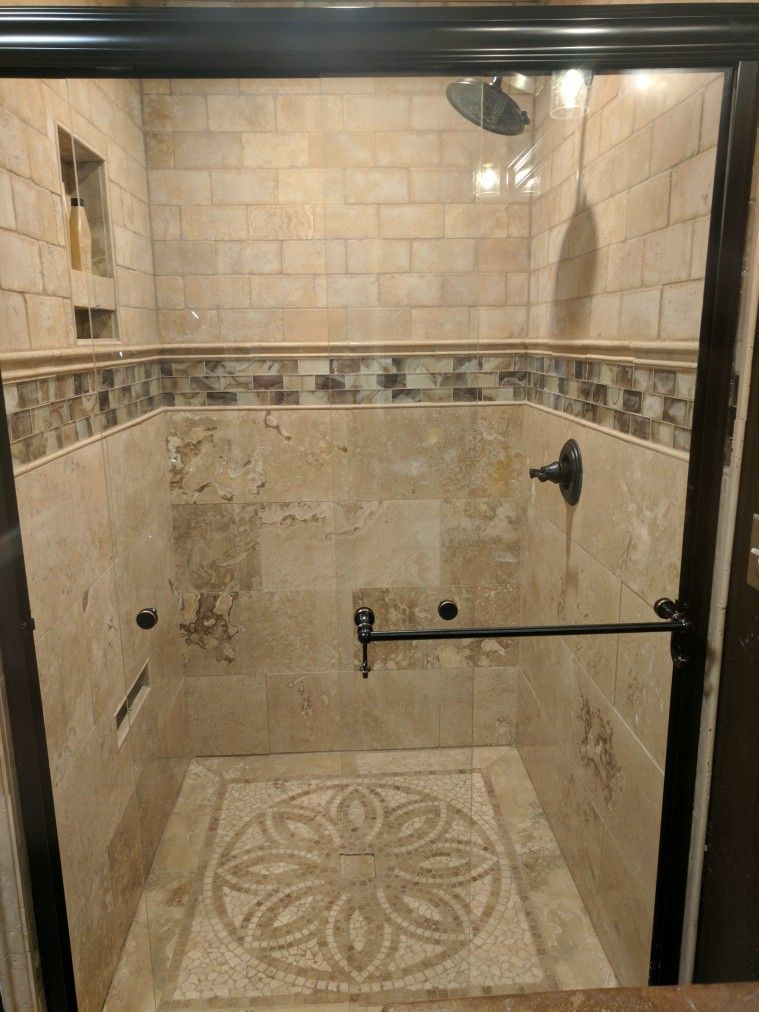 beatiful shower stall in bathroom renovation  i love the tile work on the floor and the color of