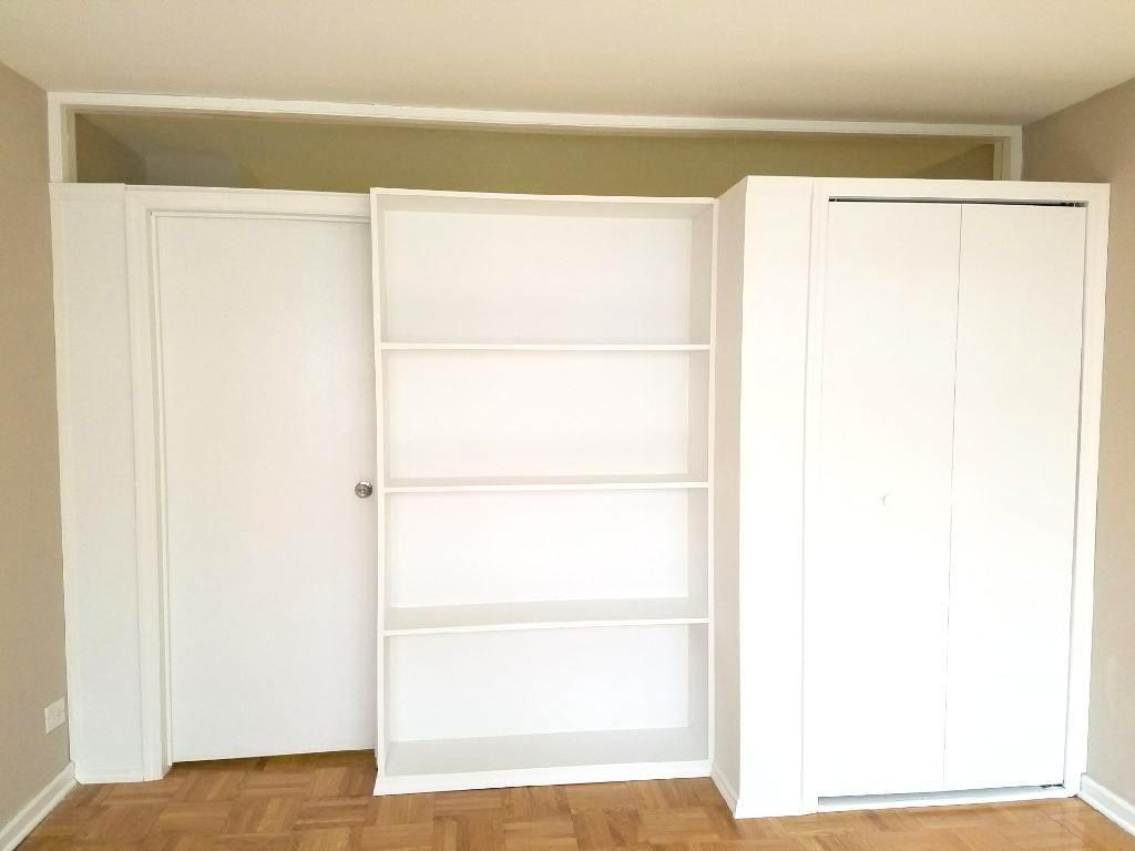 Closet Bookcase Partition With Plexiglass Transom Call Us