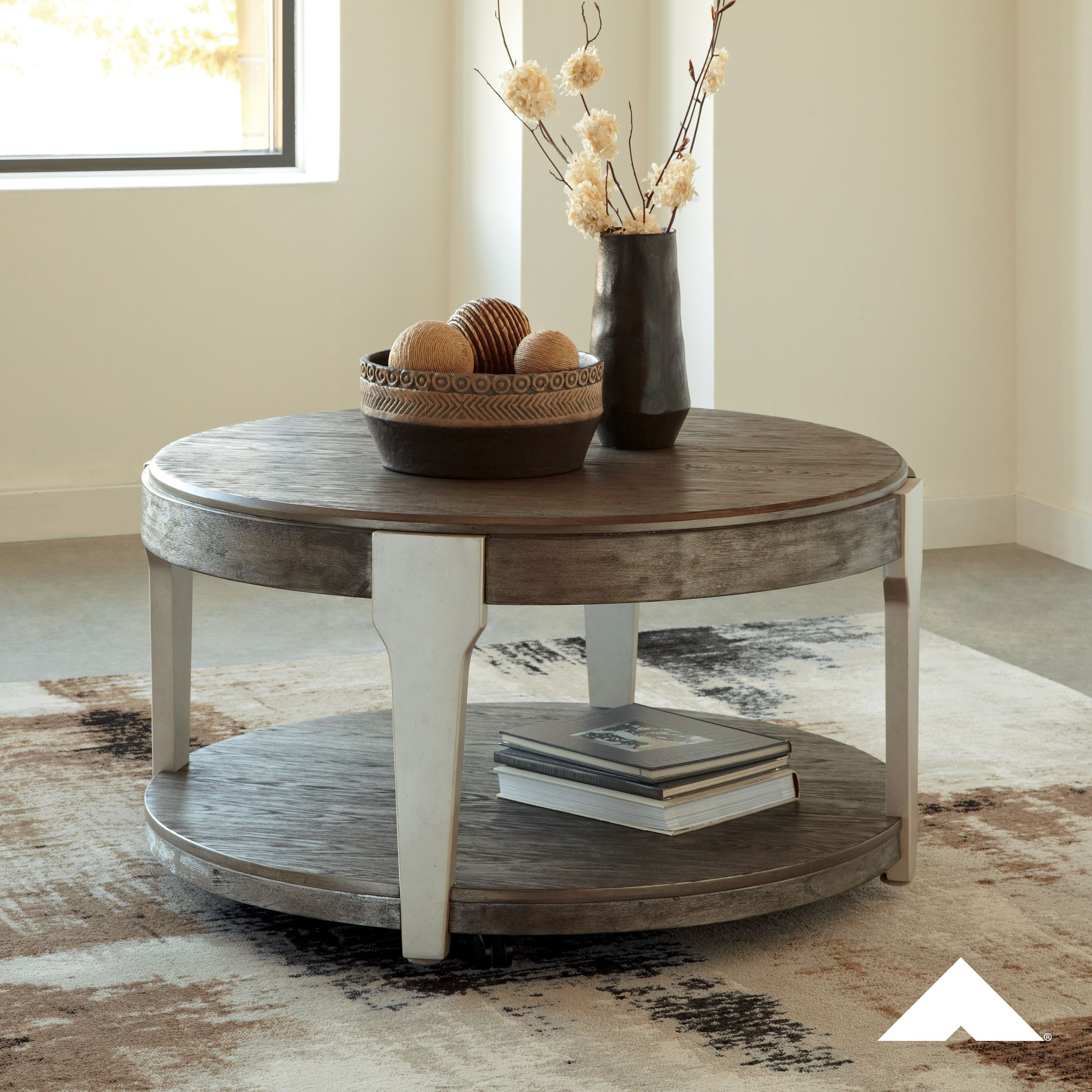 Brenzington Grayish Brown And Silver Round Cocktail Table By Ashley Furniture Ashleyfurniture F Round Cocktail Tables Coffee Table Coffee Table With Shelf