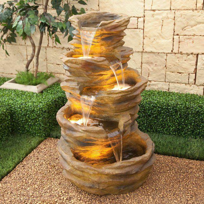 wasserfall brunnen stein pflanzen feuerstelle holz sessel, Hause und garten