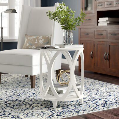 null A smooth, matte finish and solid pinewood structure make this end table just right for any farmhouse-inspired living room or bedroom. Its interlocking plank design gives it an openwork silhouette that's just right for a coastal cottage, while the interior shelf offers just enough room to display a stack of your favorite novels or a potted plant. And we love how it comes in different colors, so you can choose the one that works best for your humble abode. Best of all, this table comes fully