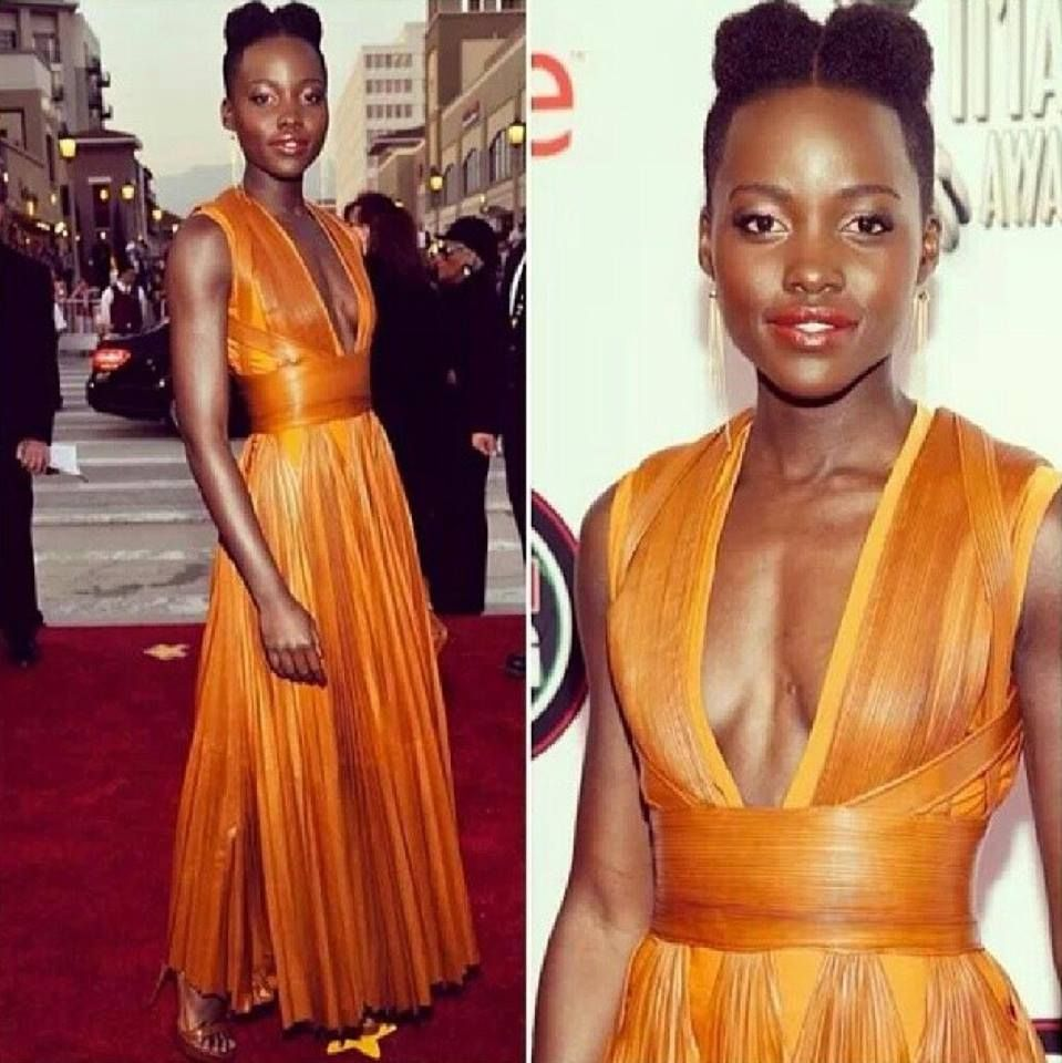 The Lady of the hour rocking her teeny weeny afro. Lupita Nyong'o won The Outstanding Supporting Actress in a Motion Picture Award and was a sight to behold on the Red Carpet. Her Givenchy gown compliments her so well, she can do no wrong at the moment!