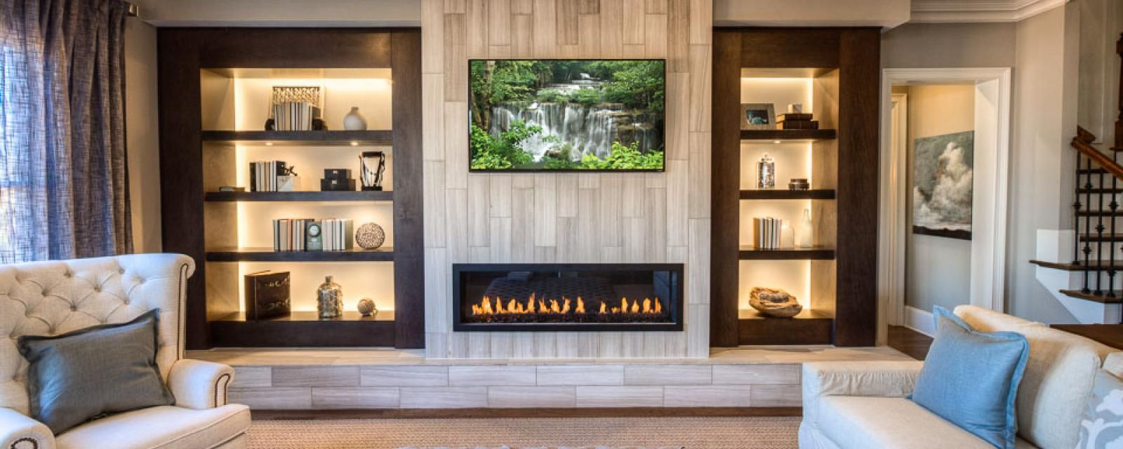 back lit built in shelves contribute a modern touch to a luxury