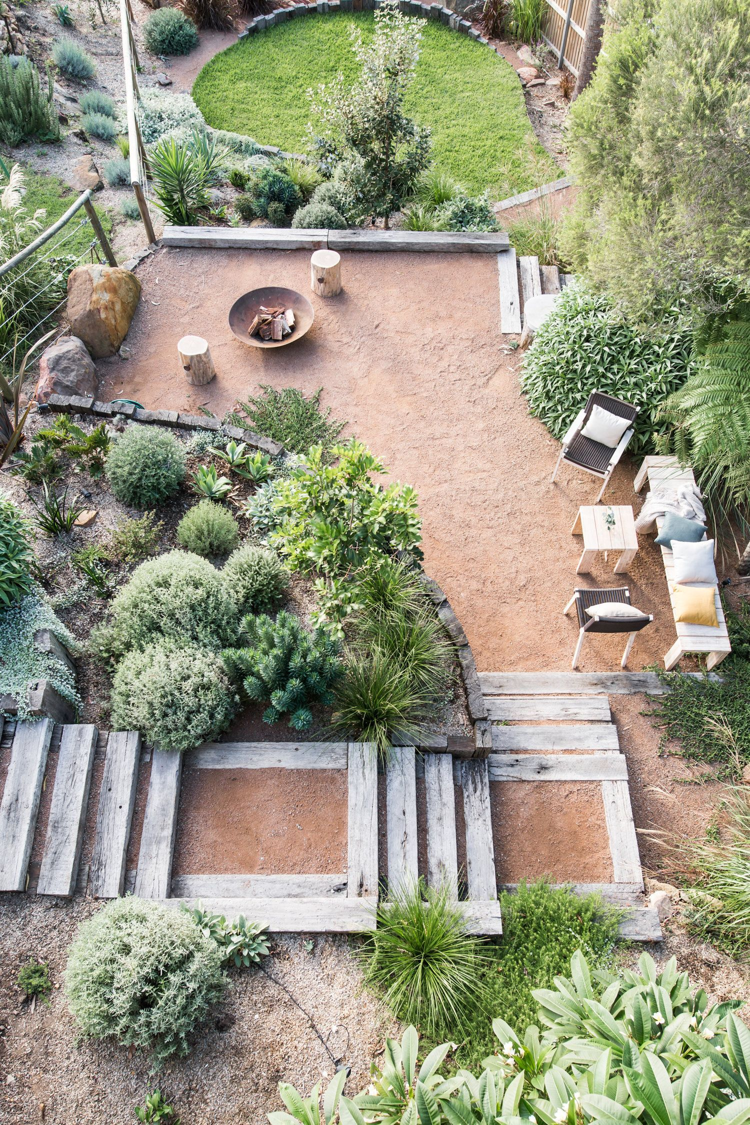 I love the approach Fig Landscapes have to Australian backyards. Natives and hardy sculptural plants, plus natural elements and textures with just a little bit of lawn to soften the space.