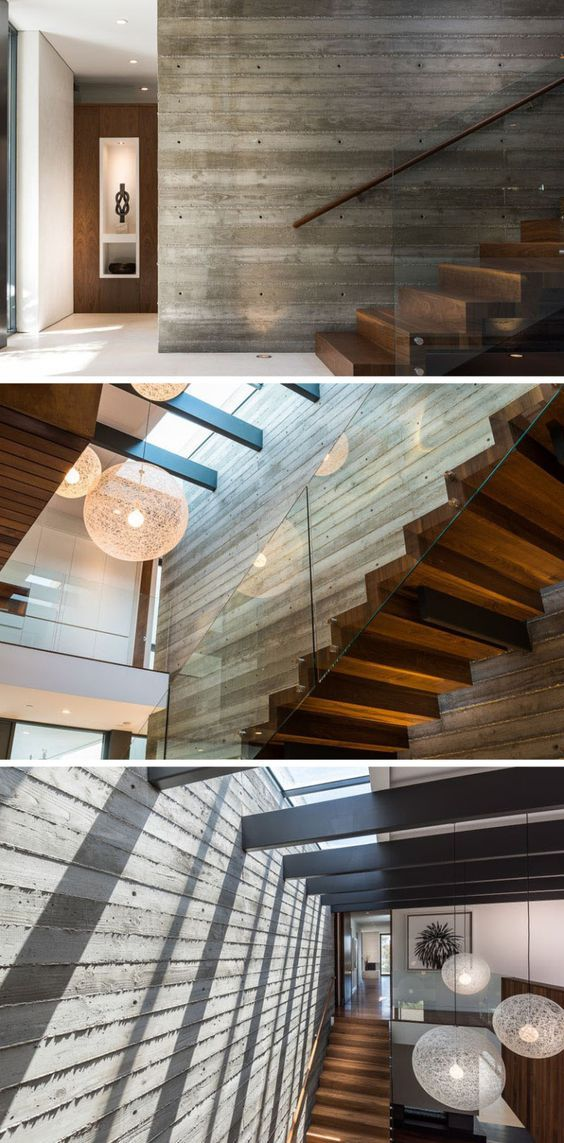 home interior design stairs%0A This home has a floating wooden staircase  set against    foot boardform  concrete