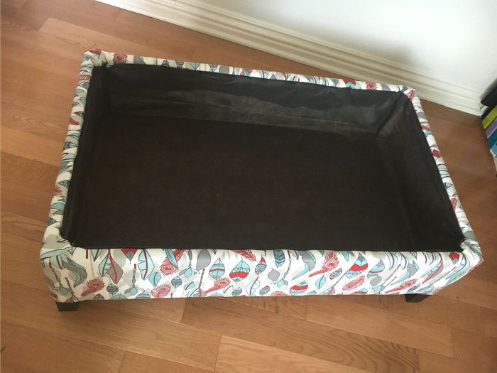 Make your own DIY upholstered storage ottoman starting with lumber from the store - it is super easy! This tutorial covers everything! The storage box is ready!