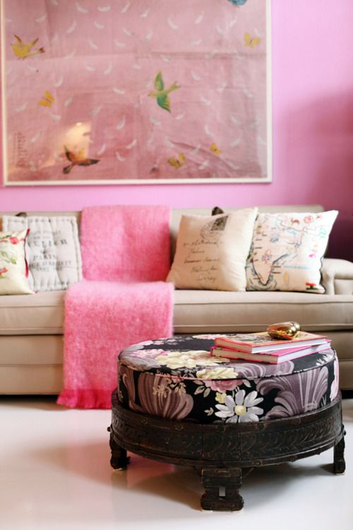 Pink walls, pink throw and a pink painting may sound like overkill ...