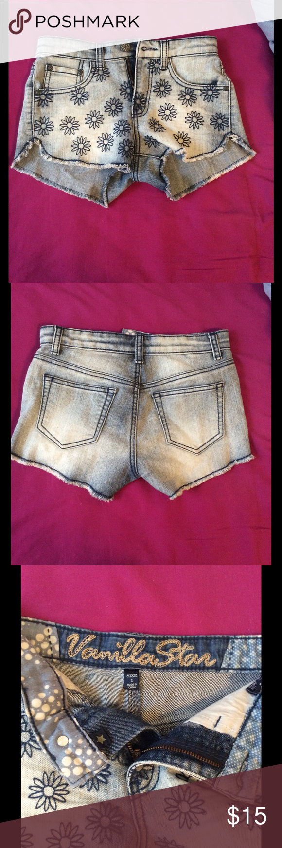 Flower shorts Blue faded jean shorts with a floral design on the front. Super cute only worn once. Vanilla Star Shorts Jean Shorts