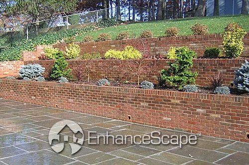 Classic Brick Retaining Wall For Your Patio Stone Patio Designs Stone Landscaping Outdoor Gardens
