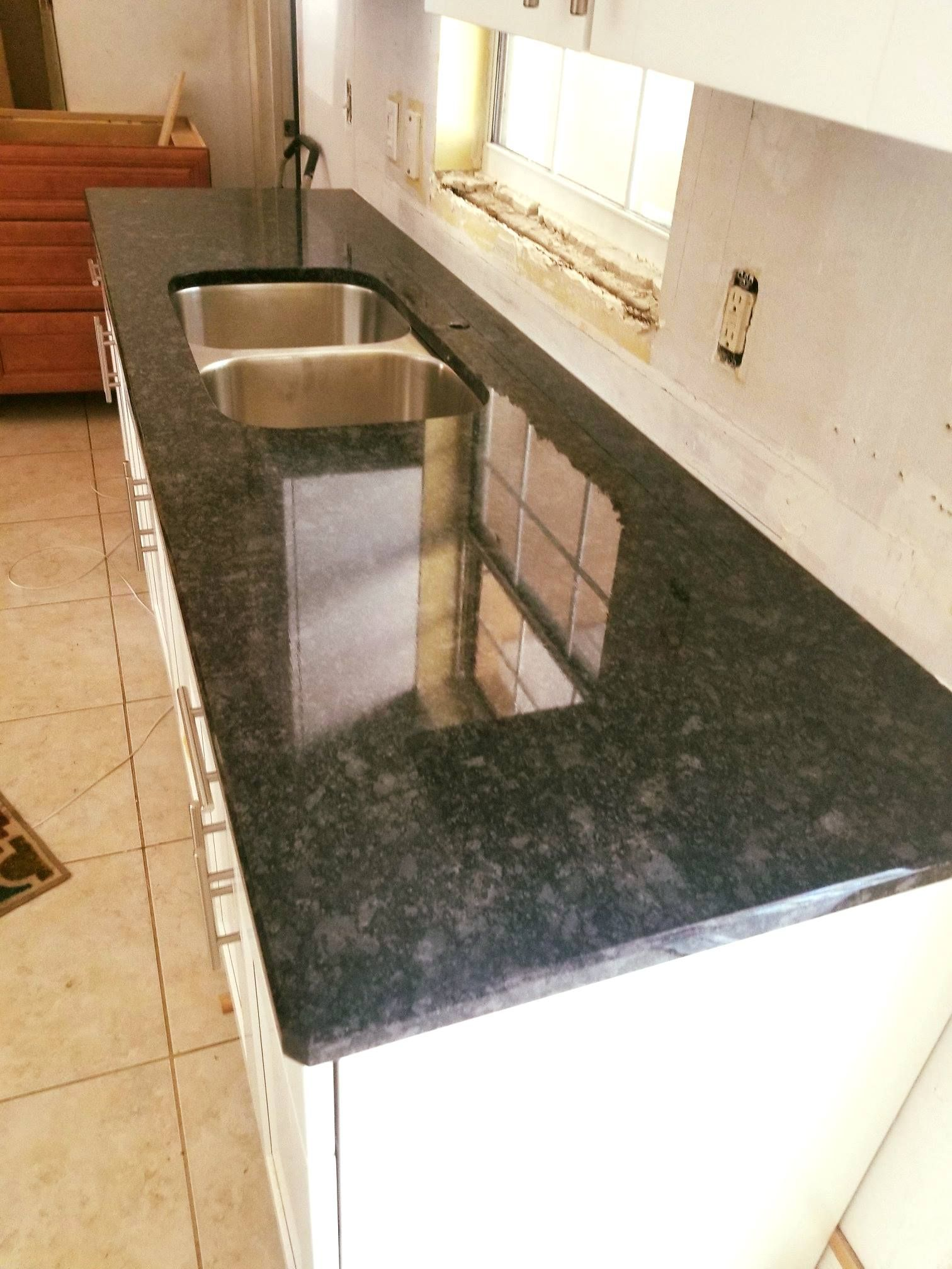 Beautiful Kitchen Countertop Made By Using Iconic Steel Gray Color