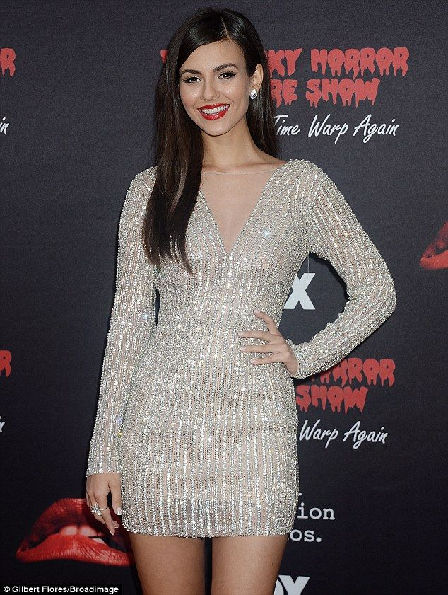 A pop of color:Victoria wore her dark brunette sleek while sporting bold red lipstick and defined brows