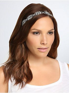 "<p>Time to turn over a new style leaf. Sparkling gemstones embellish a leaf applique, a shiny style that will complement any hair color this season. Stretch black band.</p>  <ul> 	<li>10 1/2"" long</li> 	<li>Man-made materials</li> 	<li>Imported</li> </ul>"