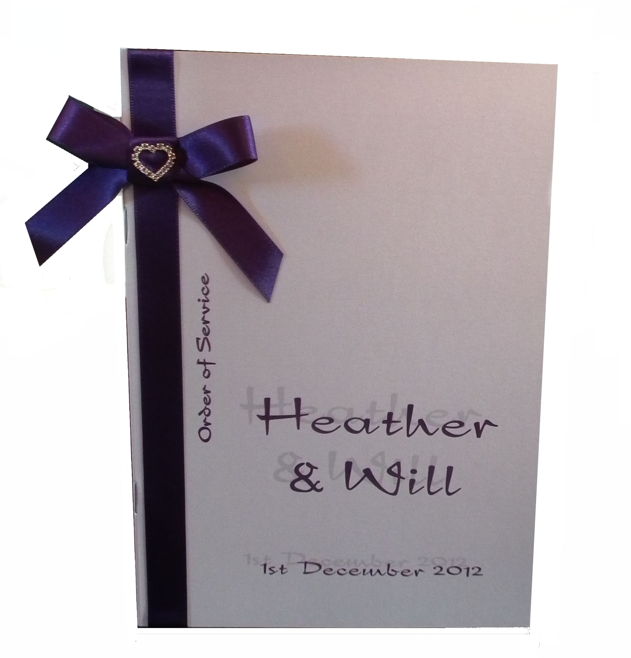 White and Cadbury Purple wedding Order of Service with silver toned diamante heart on bow www.lilguy.co.uk