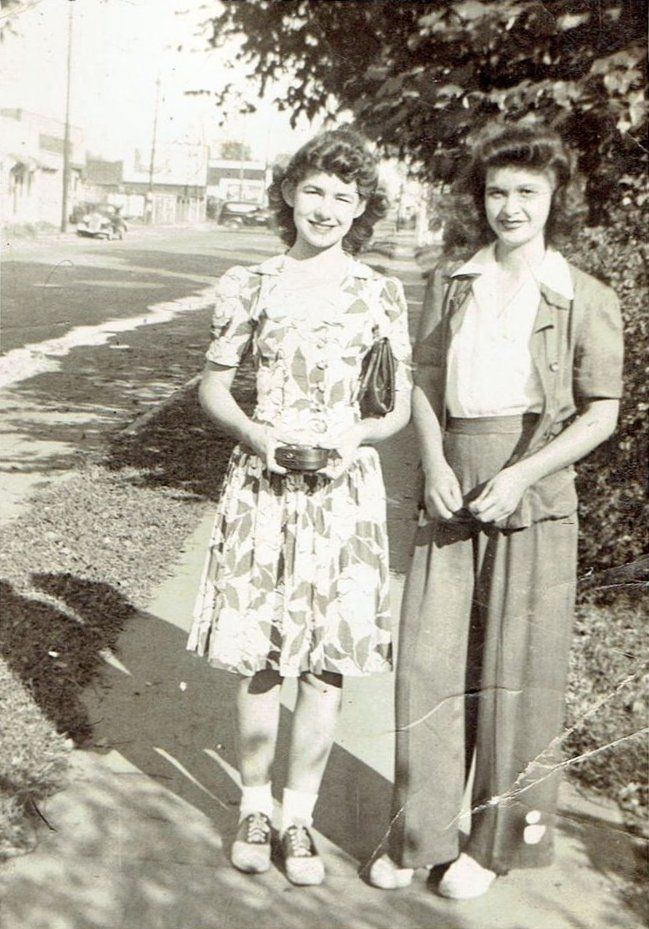 1940s found photos women teen girls on sidewalk day dress floral saddle shoes socks hair purse wide leg pants sweater blouse shirt street style War Era WWII