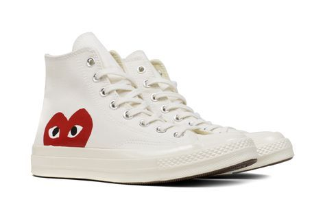 e29158af5311 The concept of the Comme des Garcons PLAY line is design by not designing.  Characterized by the iconic red heart logo designed by artist Filip  Pagowski